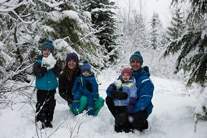 Parents and children playing on snow