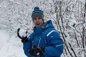 Surprised man throwing snowball