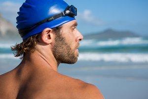 Close up of shirtless athlete looking away