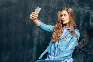 girl taking selfie by phone