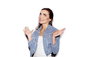 happy woman in blue plaid shirt