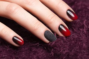 Shot beautiful manicure with gradient on female fingers. Nails design. Close-up