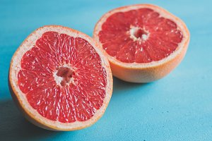 Ruby red grapefruit on blue