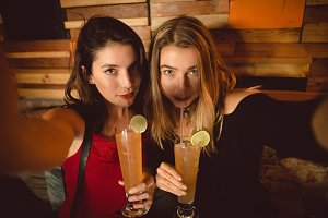 Portrait of beautiful women drinking cocktail