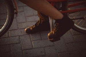 Woman paddling bicycle