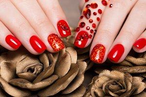 Shot beautiful manicure with rhinestones on female fingers. Nails design. Close-up
