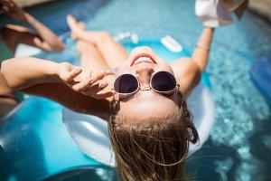 Beautiful woman relaxing in swimming pool