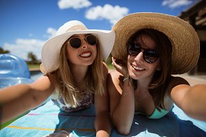 Happy women taking sunbath