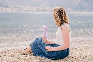 romantic woman sit on beach