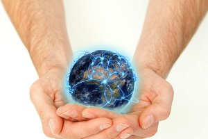 Masculine hands holding a connected planet globe