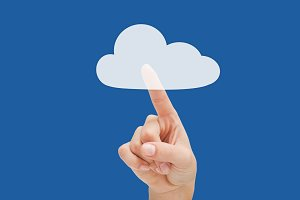 Finger pointing to a graphic cloud  on blue background