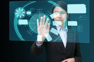 Businesswoman standing while touching at a hologram concentrated