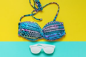 bathing suit and white sunglasses