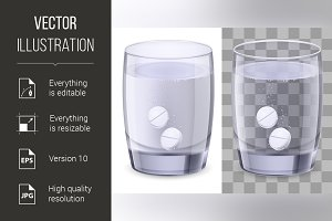 Glass of water and pills