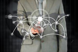Businessman's finger activating futuristic touchscreen