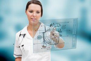 Nurses looking at a clipboard in hospital ward