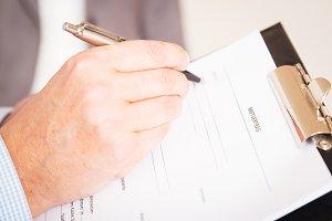 Man Filling Out A German Rental Agreement, Mietvertrag