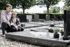 widower on cemetery
