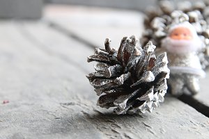 Christmas background, fir cones and Santa Claus