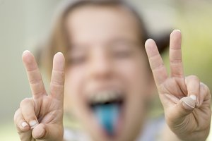 Girl with focused fingers