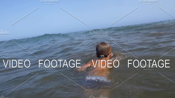 Child swimming in the sea