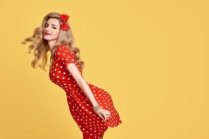 Fashion Beauty.PinUp Girl Smiling.Polka Dots Dress
