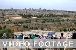 Tourists look at the Jerusalem Old City timelapse