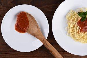 Spaghetti and Sauce on White Plates