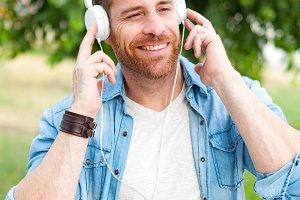 Casual men with white headphones