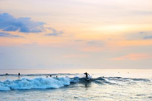 Surfing on Bali at sunset