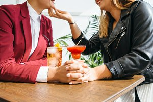 Side view of lesbian couple in bar