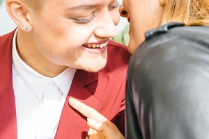 Gentle laughing lesbian couple