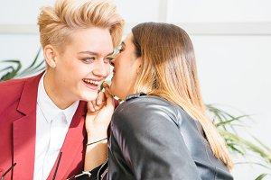 Cheerful lesbian couple talking