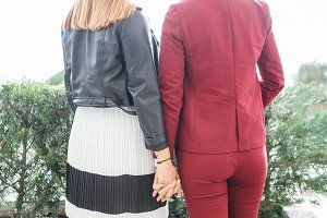 Anonymous girlfriends holding hands