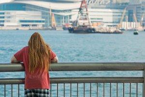 Redhead looking in Pier