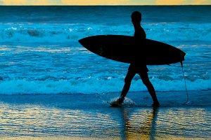 Surfer at sunset, Bali island
