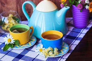 Tea set on the dark blue tablecloth