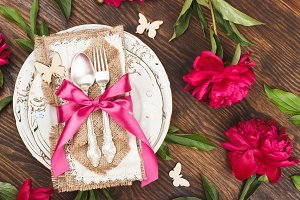 Tableware and silverware with peonies