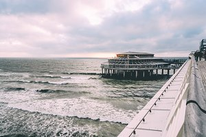 Pier and Sea with Moody Sky