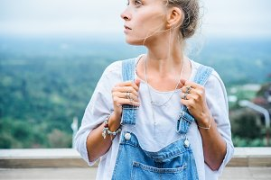 Girl in denim overalls