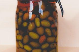 Olives vegetables in brine, faded vintage look