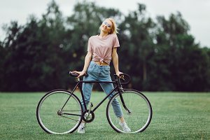 Woman posing with cycles