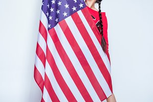 girl posing with big american flag