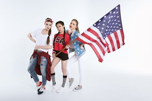 women posing with american flag
