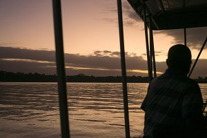 Man on boat at sunset