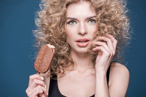 young woman holding ice cream