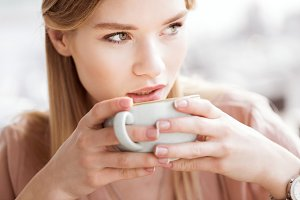 confident woman drinking coffee