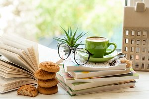Coffee cup and books on window sill