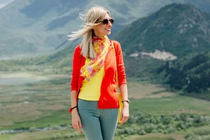 blonde girl travel in mountains