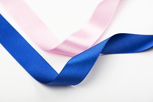 Abstract background of pink and blue ribbons on white background. Copy space.